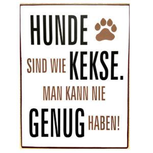 Schild aus Metall mit dem Spruch Hunde sind wie Kekse . Man kann nie genug haben!